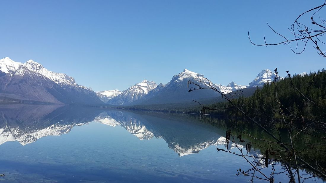 GLACIER NATIONAL PARK MONTANA MOUNTAIN REFLECTING OFF THE LAKE By Familycountrysteele Photography