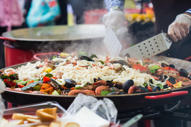 Person preparing food at market stall