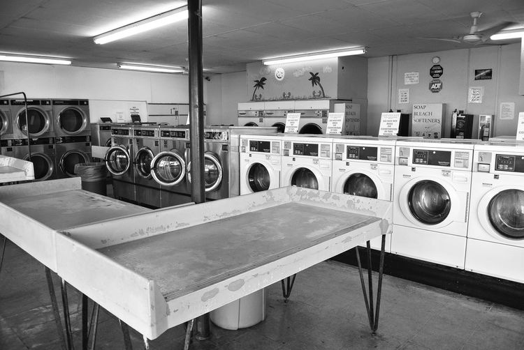 Tables by washing machines in laundry