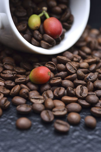 Fragrant pure delicious coffee beans Advanced Coffee Coffee Fruit Pure Bake Close-up Coffee Bean Coffee Beans Coffee Cup Day Delicious Featured Food Food And Drink Fragrant Freshness Healthy Eating Indoors  Need No People Nut - Food Raw Coffee Bean Still Life Table