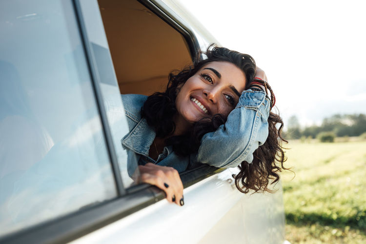 Portrait of smiling young woman in car