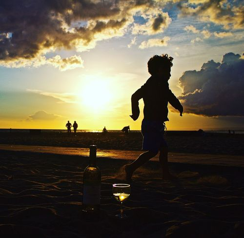 Child in sunset Water Tranquil Scene People And Places Orange Color Children Child Wine Whitewine Clouds And Sky Clouds Fregene One The Way Fine Art Photography First Eyeem Photo People Together Sunset Sunset Silhouettes Sunsetporn Sunset And Clouds  Sunset Lovers Sunset_captures Sunsetphotographs Beach Summer Wineglass Traveling Home For The Holidays