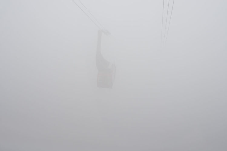 Cable car in the fog Beauty In Nature Cable Cable Car Color Day Elevated View Extreme Weather Fog Foggy Foggy Day Foggy Morning Foggy Weather Hanging Misty Mode Of Transport No People On The Move Overhead Cable Car Power In Nature Scenics Steel Cable Transportation Weather