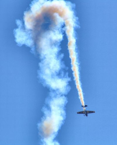Aerobatics Air Vehicle Airplane Airshow Blue Cloud - Sky Day Flying Low Angle View Military Airplane Mode Of Transportation Motion Nature No People on the move Outdoors Plane Sky Smoke - Physical Structure Speed Trail Transportation Vapor Trail
