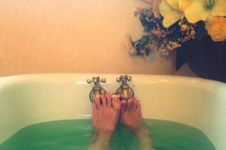 Barefoot in a bathtub