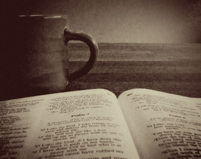 Devotions to start the day Bible Bible Study Ceramic Mug Close-up Coffee Devotions Education Indoors  Morning No People Open Page Paper Script Sepia Study Table Tea Time Text
