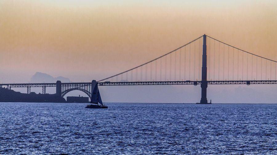 View of suspension bridge at sunset