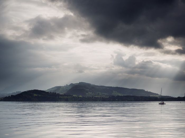Dramatic Sky Stormy Weather Storm Cloud Storm Cloud - Sky Sky Water Waterfront Beauty In Nature Scenics - Nature Sea Nautical Vessel Tranquility Nature Tranquil Scene Transportation Outdoors Non-urban Scene