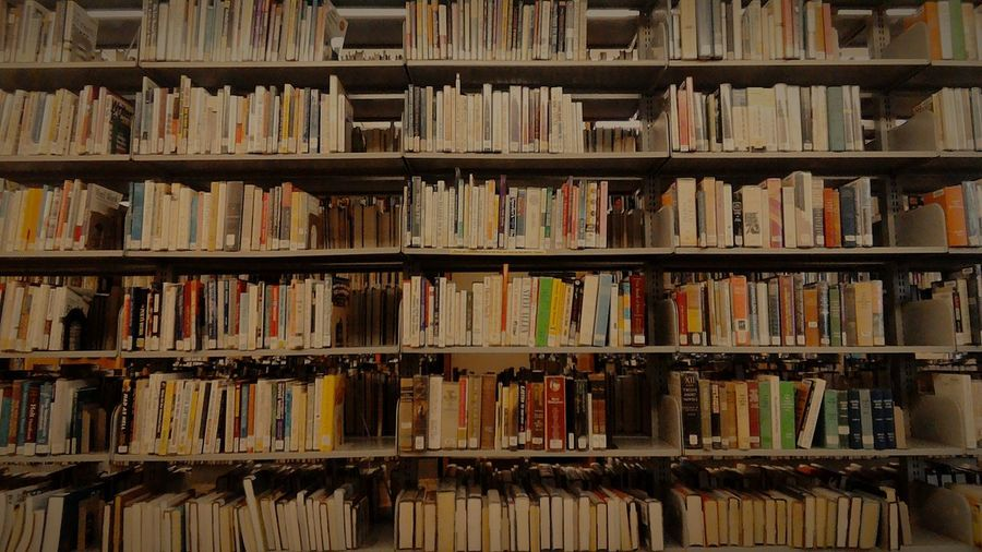 Full frame shot of bookshelves in library