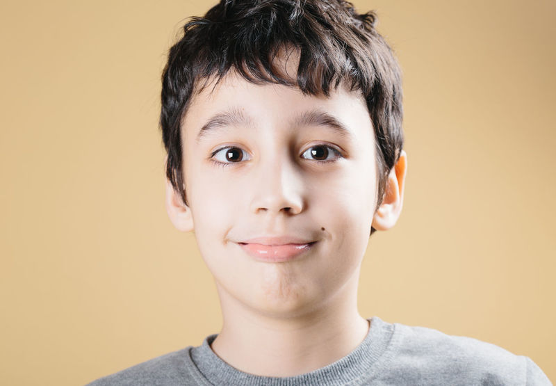 Boy looking at you and smiling. 8 Years Old Beige Background Boy Caucasian Childhood Childhood Memories Cilantro Cildren Close-up Cute Expression Happy Headshot Inocence  Looking At Camera One Person People Portrait Smile Smile ✌ Smiling Studio Shot