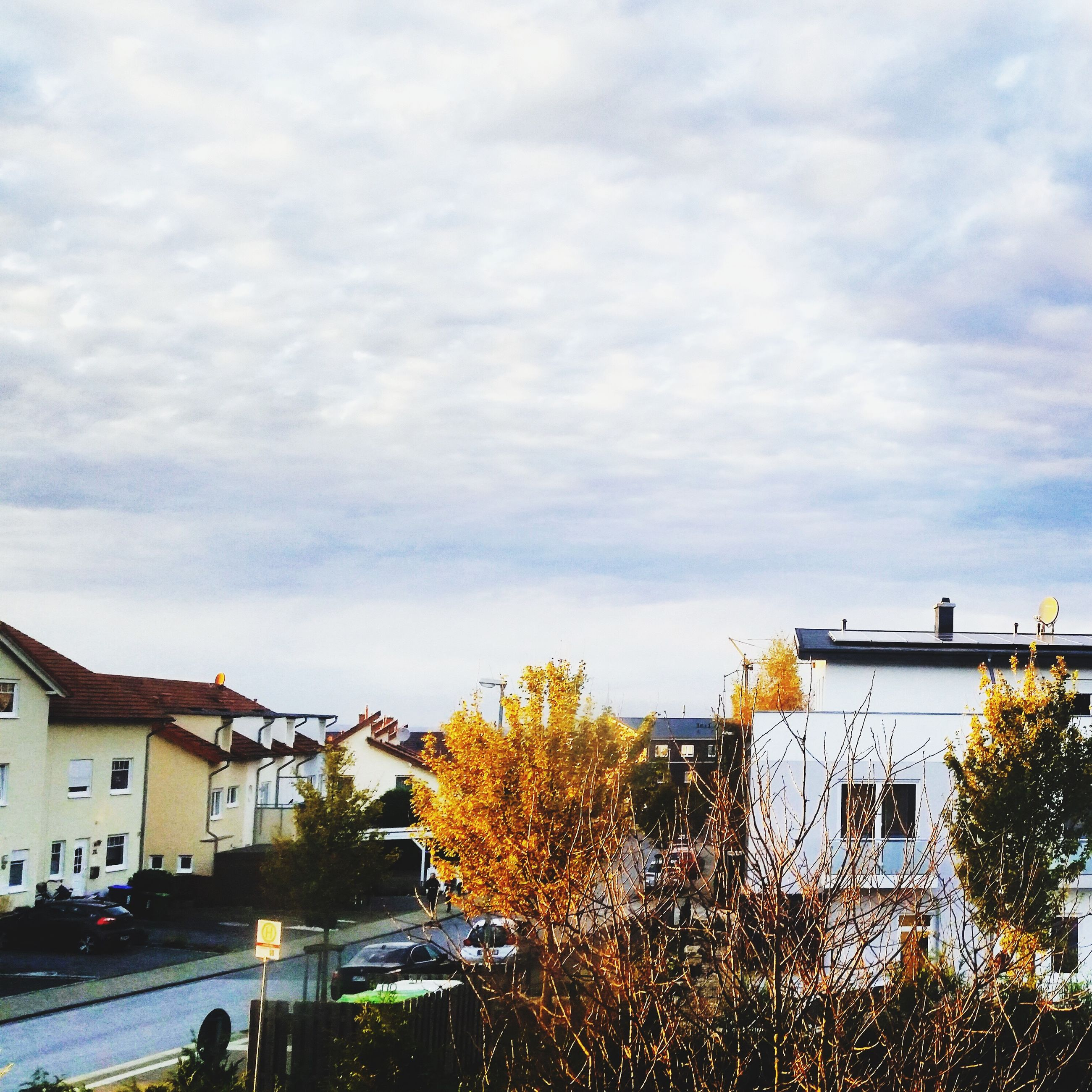 building exterior, architecture, built structure, sky, city, cloud - sky, residential building, residential structure, building, low angle view, cloudy, tree, cloud, house, city life, residential district, outdoors, day, street light, no people