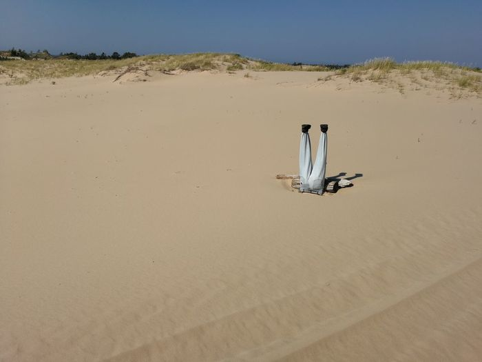 Sand in desert against sky