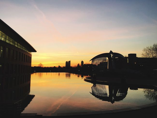 Architecture Reflection Built Structure Building Exterior Sunset Water Sky Waterfront City No People Outdoors Nature Day Library The City Light Landrover  Grunge VSCO TBT  Art Dark Pool Sunset_collection Sunshine