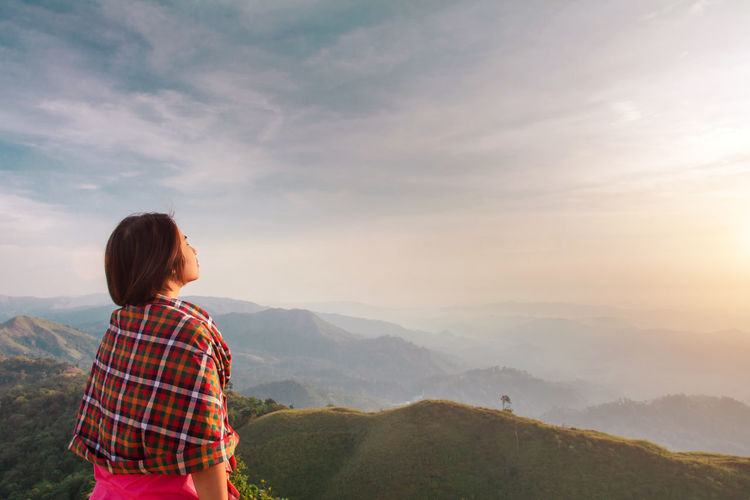 One Person Mountain Sky Leisure Activity Beauty In Nature Scenics - Nature Real People Rear View Cloud - Sky Standing Lifestyles Non-urban Scene Nature Mountain Range Tranquility Looking At View Casual Clothing Women Tranquil Scene Outdoors Hairstyle