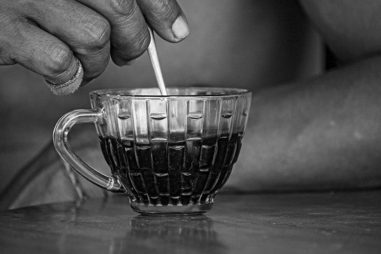Human Hand Cup Hand Food And Drink One Person Mug Human Body Part Refreshment Holding Drink Real People Table Indoors  Close-up Coffee Cup Lifestyles Coffee Focus On Foreground Hot Drink Finger Tea Cup Stirring Spoon Vintage Black And White Old