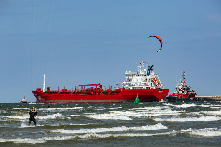 Baltic Baltic Sea Adventure Aquatic Sport Day Extreme Sports Kiteboarding Leisure Activity Mode Of Transportation Motion Nature Nautical Vessel Outdoors Parachute Paragliding Real People Sea Sky Sport Surfing Transportation Water Wave