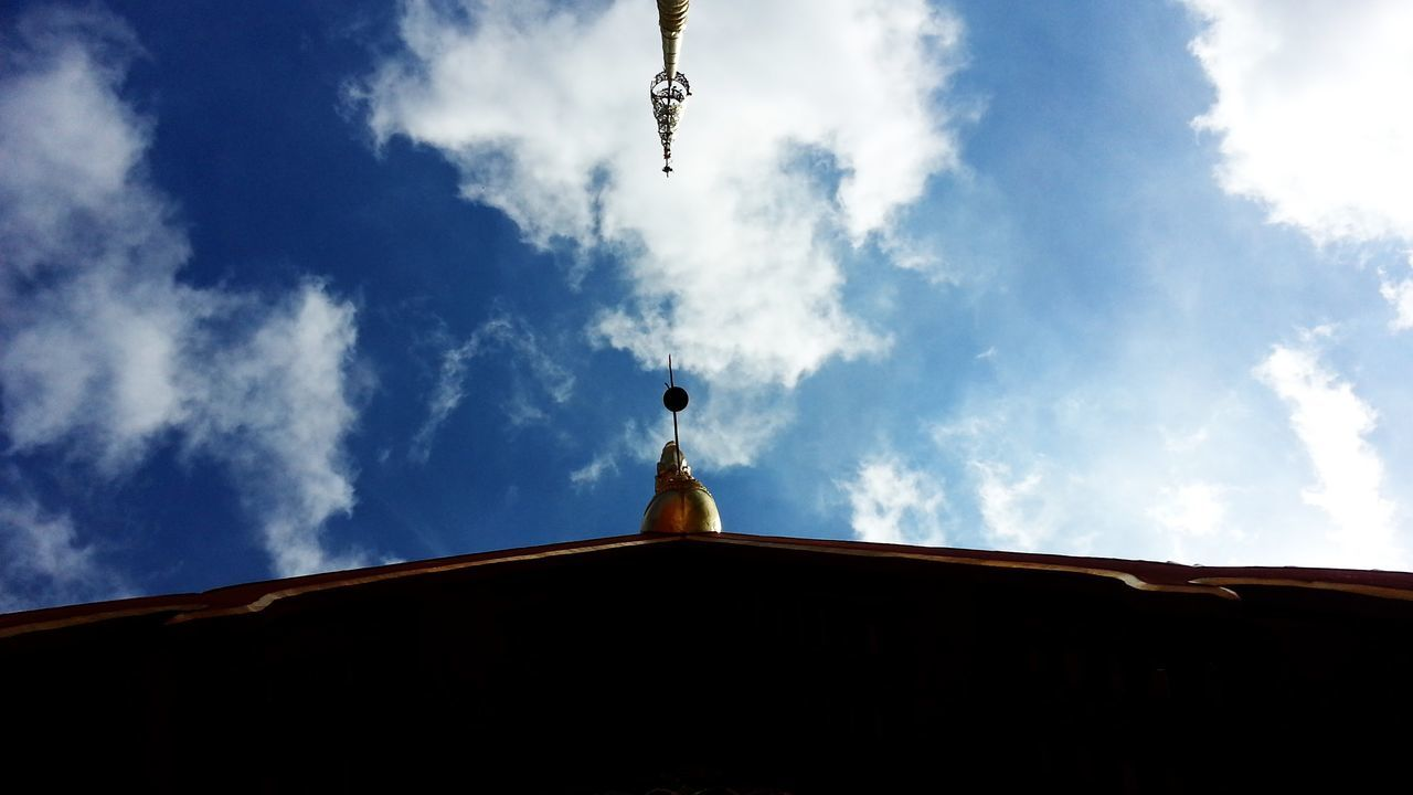 low angle view, sky, cloud - sky, roof, day, architecture, built structure, cross, no people, outdoors, building exterior