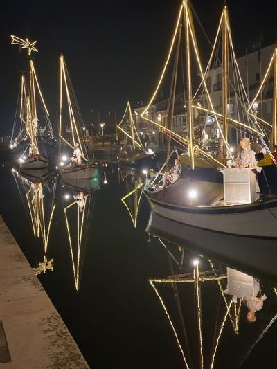 Illuminated commercial dock at night