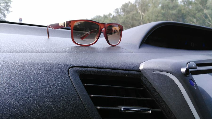 EyeEm Selects sunglasses,long drive.... Sunglasses :) Sun Glasses Rayben😎 Rayben Raybens Car Interior Long Drives ❤ Fastcar Glasses Or No Glasses? Glass - MaterialStanding One Person Glassware