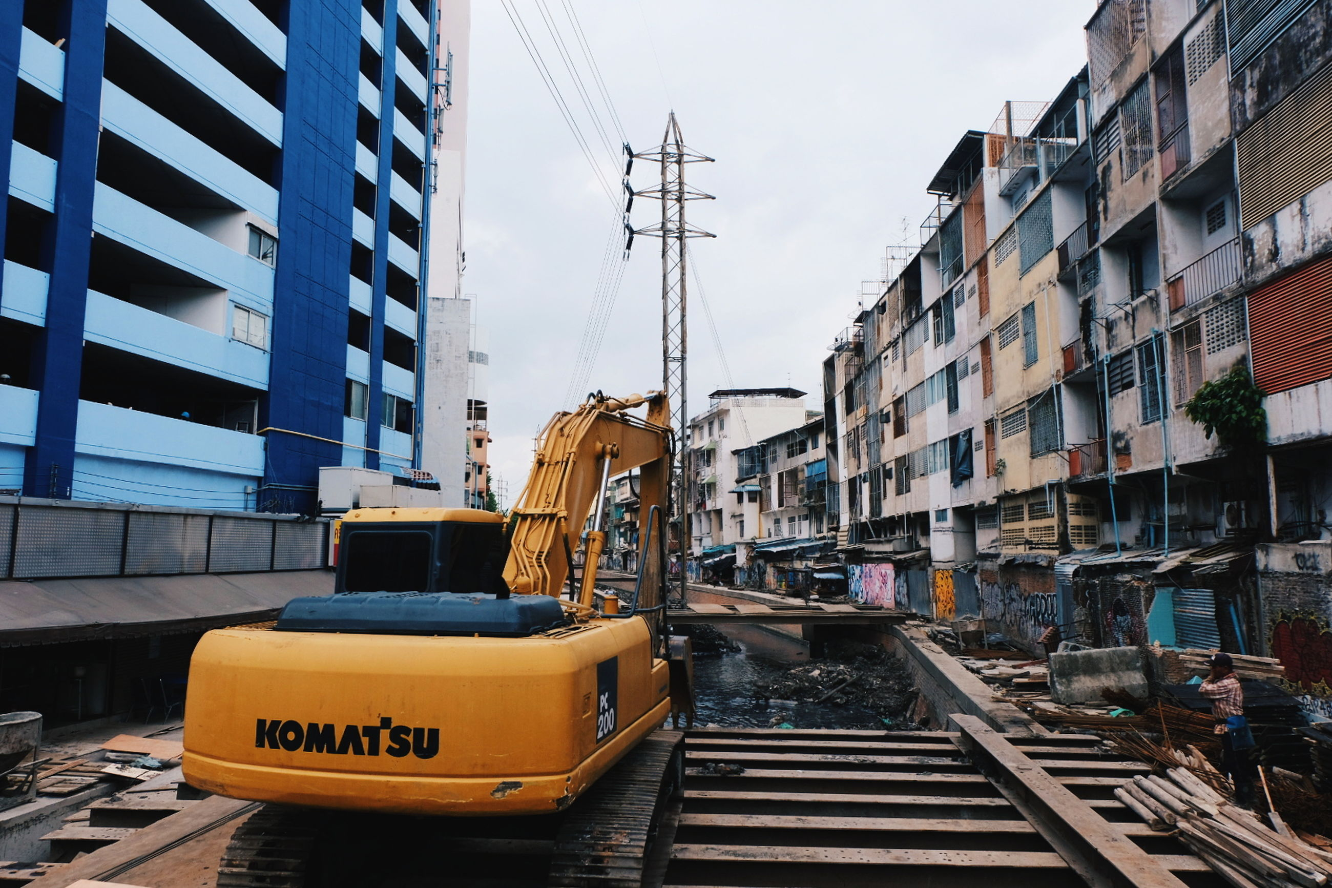 architecture, built structure, building exterior, transportation, sky, machinery, city, day, mode of transportation, nature, crane - construction machinery, building, outdoors, no people, communication, construction industry, nautical vessel, text, industry, public transportation