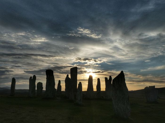 Sunset over Standing Stones of Callanish History Callanish Stones Callanish Stones VisitScotland Scotland Outer Hebrides Isle Of Lewis Sunset #sun #clouds #skylovers #sky #nature #beautifulinnature #naturalbeauty #photography #landscape Sky Cloud - Sky Architecture Sunset Nature Built Structure History The Past Travel Destinations No People Ancient Land Building Environment Old Ruin Dramatic Sky Scenics - Nature Outdoors Landscape