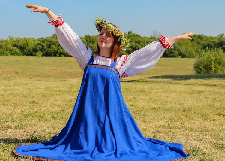 Photo of a young girl in the Russian national dress. Summer Summertime Young Girl Young National Costume National Clothes National Dress Wreath Circlet Of Flowers Russian Girl Russian Clothes Russian Dress Outdoors Outdoor Photography