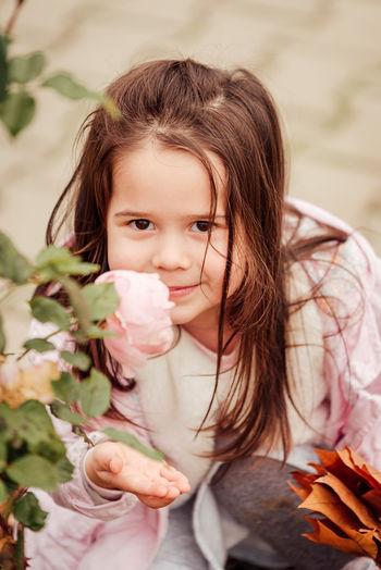 Portrait of cute girl smelling flower