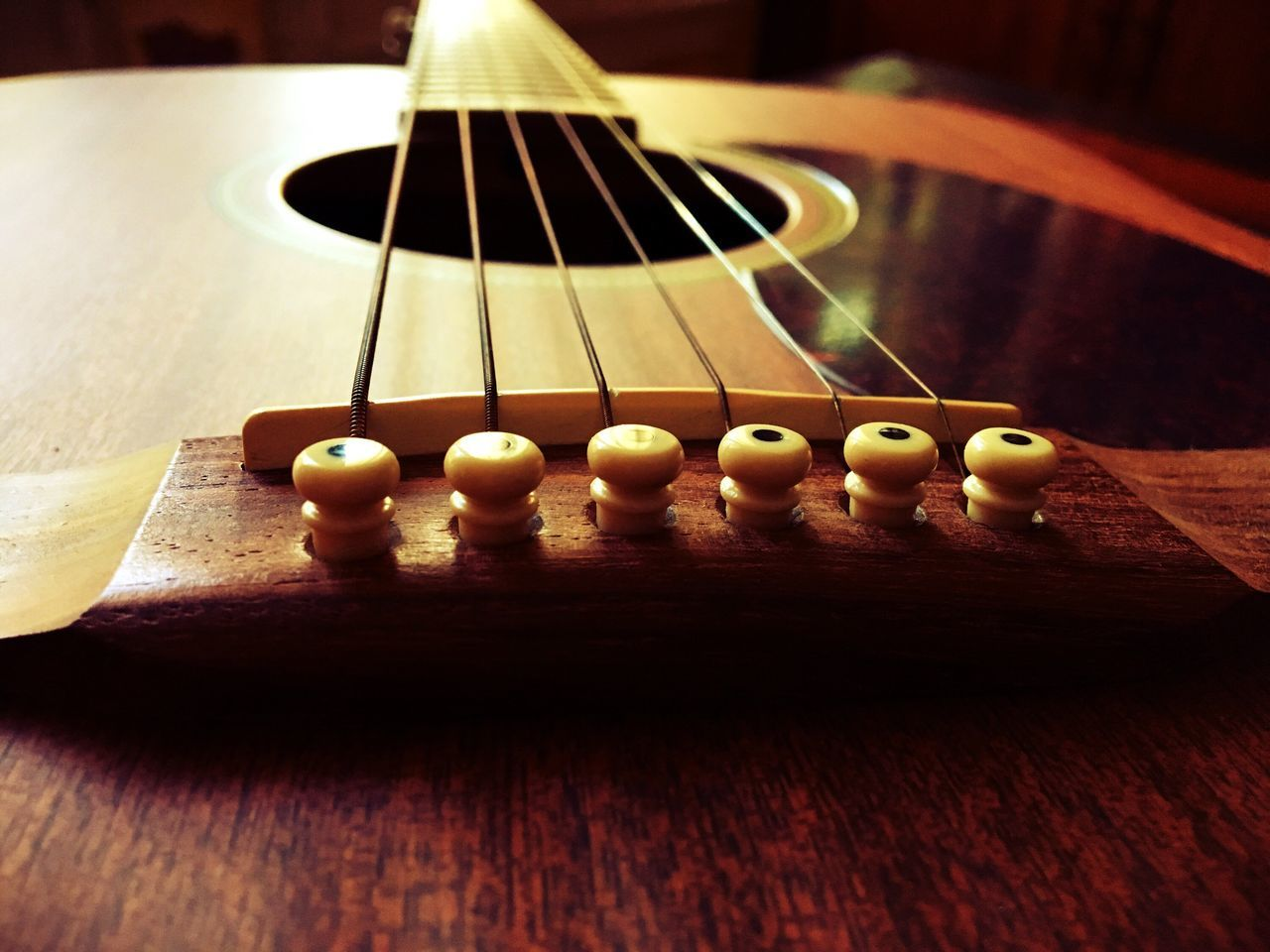 indoors, still life, table, no people, wood - material, music, guitar, close-up, musical instrument string, day