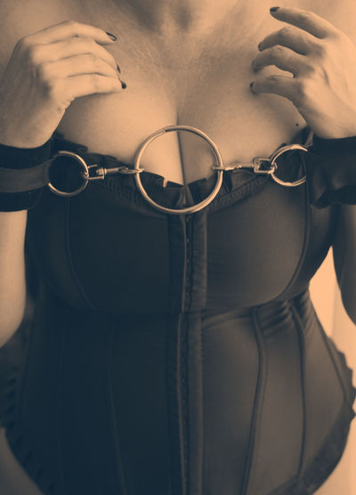 Midsection of sensuous woman with handcuffs