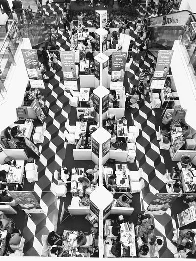 Traveling exhibition High Angle View Large Group Of People Crowd Day People EyeEmNewHere Flying High Garuda Indonesia Exibition Hall Travelgram Traveling Photography Commercial Airplane Ceramic Art Architecture Interior Geometry Interior Architecture Interesting Perspectives Interior Photography Interesting Places Performance EyeEm Gallery EyeEmOnMarket From Where I Stand Black And White Friday