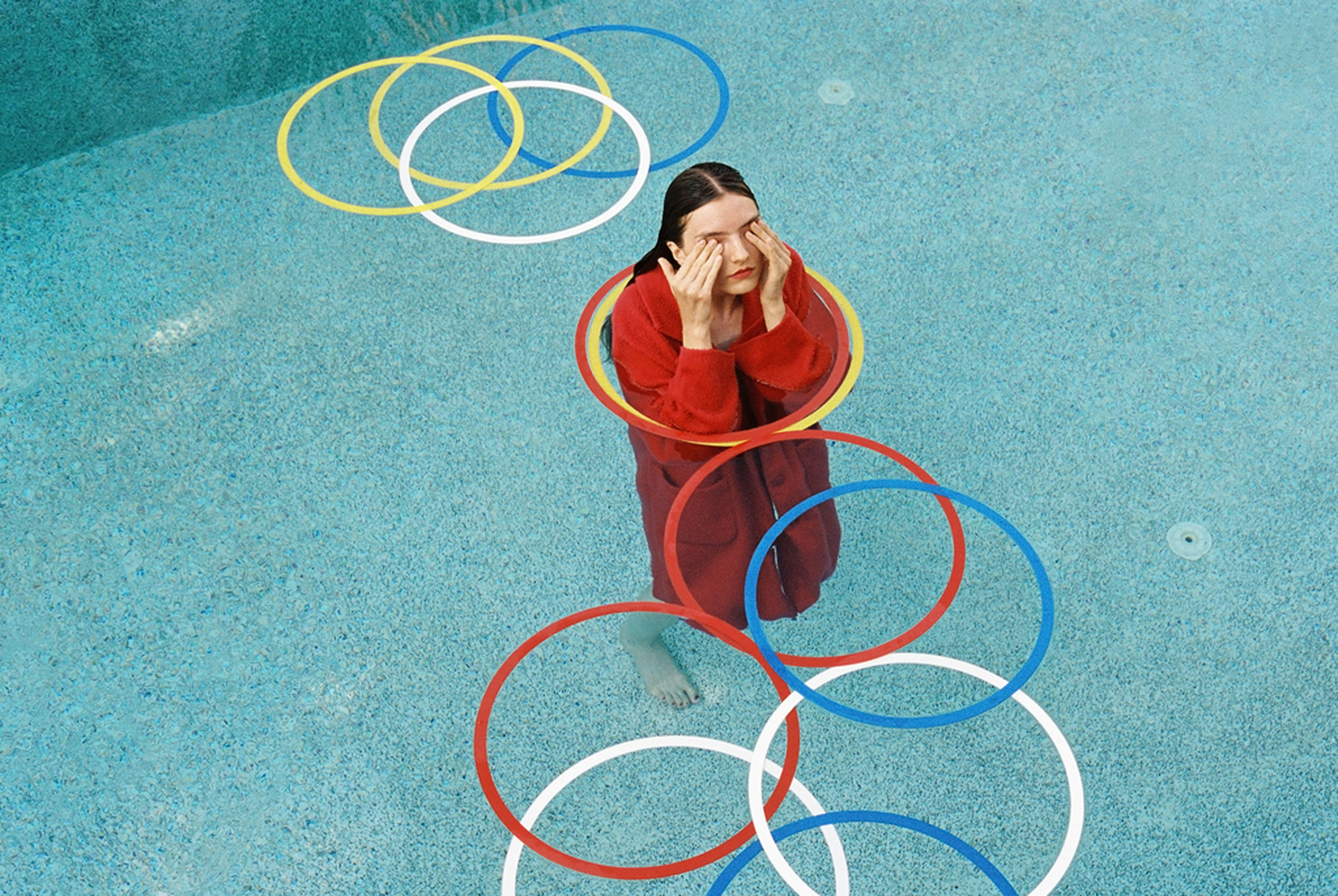 one person, young adult, casual clothing, high angle view, full length, technology, women, adult, connection, brown hair, day, plastic hoop, red, communication, holding, real people, telephone, wireless technology