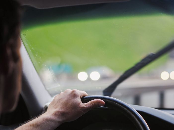Cropped image of man driving car