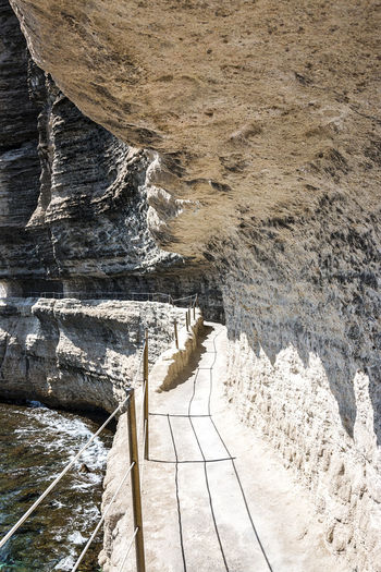 way to the Stair of the King of Aragon Les Escaliers Du Roi Aragon Rock Formation Stair Of The King Of Aragon Street Of Bonifacio Beauty In Nature Dam Day High Angle View Lime Rock Nature No People Outdoors River Rock - Object Scenics Water