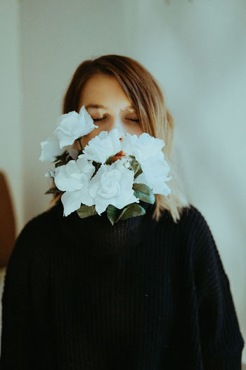 The Portraitist - 2019 EyeEm Awards One Person Indoors  Real People Young Adult Lifestyles Headshot Front View Portrait Flower Flowering Plant Young Women Wall - Building Feature Women Leisure Activity Casual Clothing Plant Close-up Waist Up Hairstyle