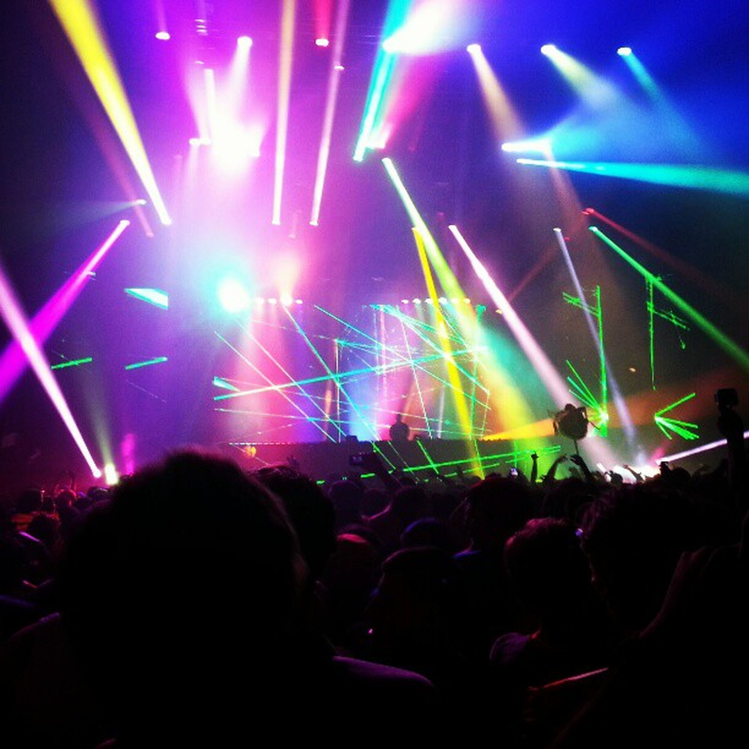 illuminated, large group of people, arts culture and entertainment, nightlife, music, night, enjoyment, crowd, person, indoors, stage - performance space, lifestyles, event, performance, men, leisure activity, youth culture, fun, popular music concert