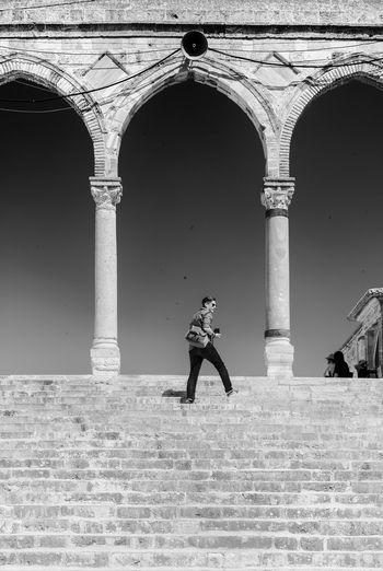 Full length of man walking on historic building