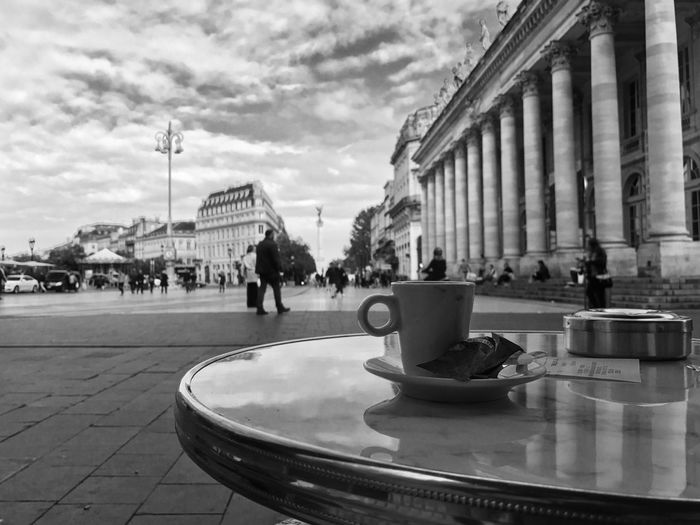 Un ristretto Building Exterior Built Structure Architecture City Incidental People Street City Life Transportation Person Sky Outdoors Eye4photography  Tranquil Scene Blackandwhite Photooftheday EyeEm Best Shots EyeEm Best Shots - Black + White Coffee Ristretto Cloud - Sky In Front Of