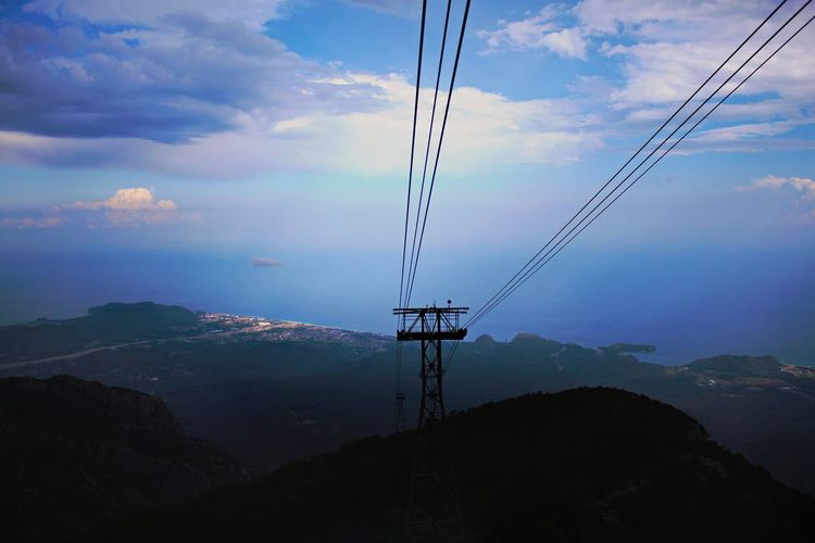 Cable Connection Cloud - Sky Sky Electricity  Power Line  Technology Fuel And Power Generation Outdoors Electricity Pylon No People Nature Silhouette Mountain Day Water Telephone Line Overhead Cable Car Beauty In Nature Ski Lift