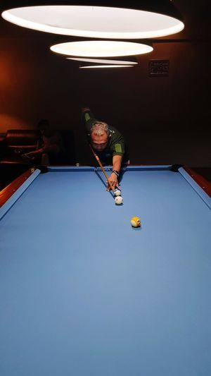 Billiard Time Billiards Billiard Billiard Table Billiard Balls Blue Table Man Dark Background Spotlights EyeEm Selects Pool Ball Competition Sport Men Playing Activity Leisure Games Males  Sportsman Pool Table Pool Cue Cue Ball