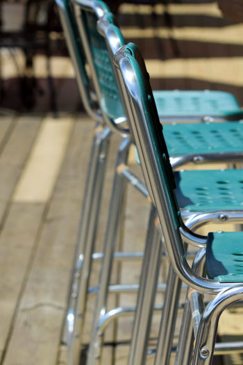Close-Up Of Empty Chairs Arranging Outdoors