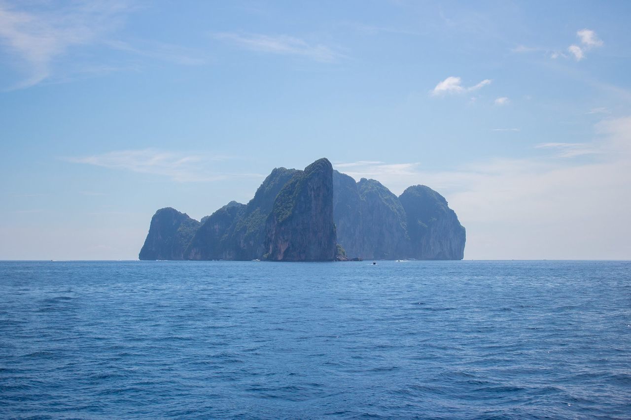 Blue sea and island against sky