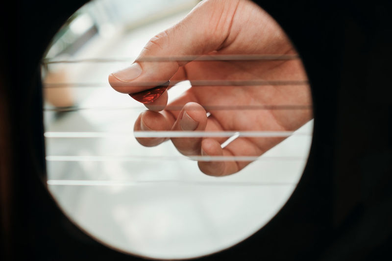 Close-up of hand holding glass window