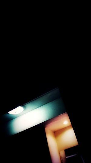 Close-up of illuminated electric lamp against black background