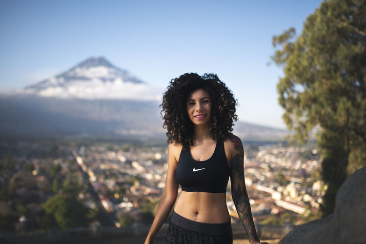 Beautiful Woman Beauty Cityscape Fitness Fitness Training Focus On Foreground Front View Hair Hairstyle Leisure Activity Lifestyles Long Hair Mountain Mountain Range Nature One Person Outdoors Portrait Real People Sky Standing Three Quarter Length Young Adult Young Women