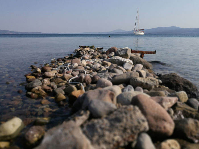 rocks and sailboat. Rock Beauty In Nature Day Nature Nautical Vessel Outdoors Rock Rock - Object Sailboat Sailing Sailingboat Sea Seascape Seaside Sky Solid Stone Water Yacht