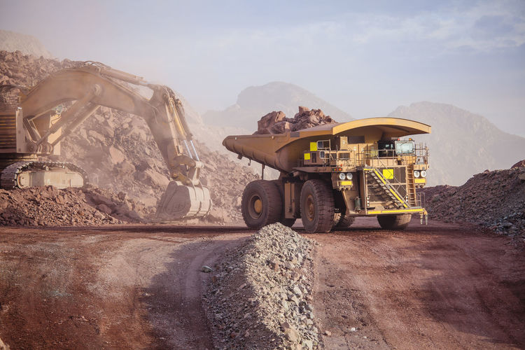 Loading of copper ore on very big dump-body truck Chile Earth Heavy Industrial Industry Minerals Road Copper  Day Dump Dump Truck Earth Mover Loading Mine Mineral Mining Mining Industry Outdoors Quarry Quarry Rock Shovel Truck Vehicle