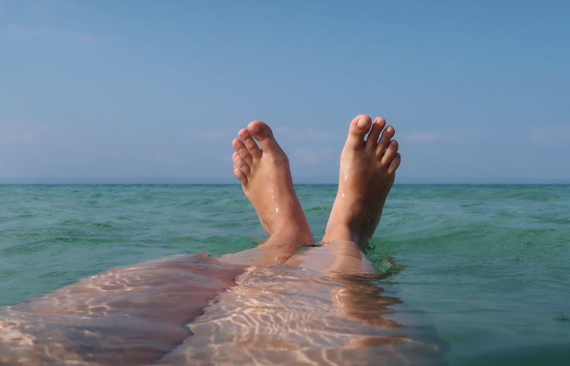 Feet up in the sea Relaxing Sea Water Nature Real People Sky Relax Relaxation Holiday Travel Feet Up Vacation Outdoors Swim Horizon Shallow Body Part One Person Human Foot Leisure Activity Horizon Over Water Human Leg Low Section Human Body Part barefoot Lifestyles Beauty In Nature Personal Perspective Day