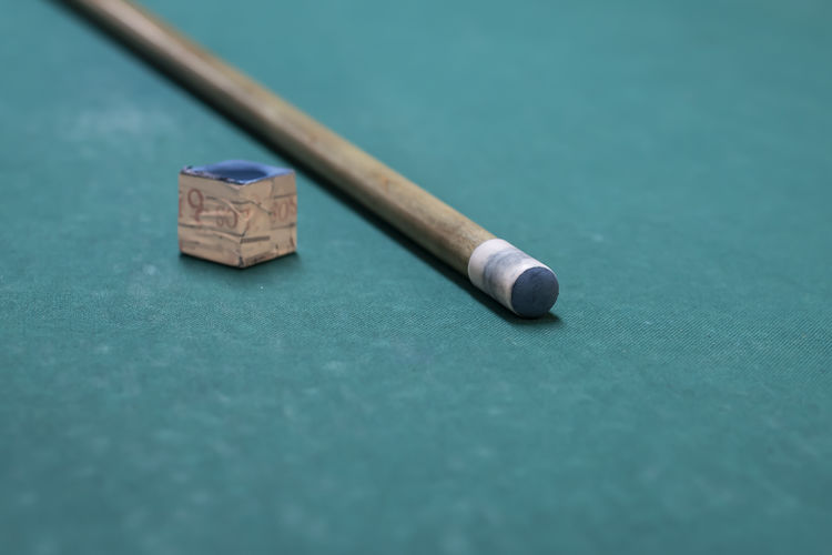 Close-up of pool cue on table
