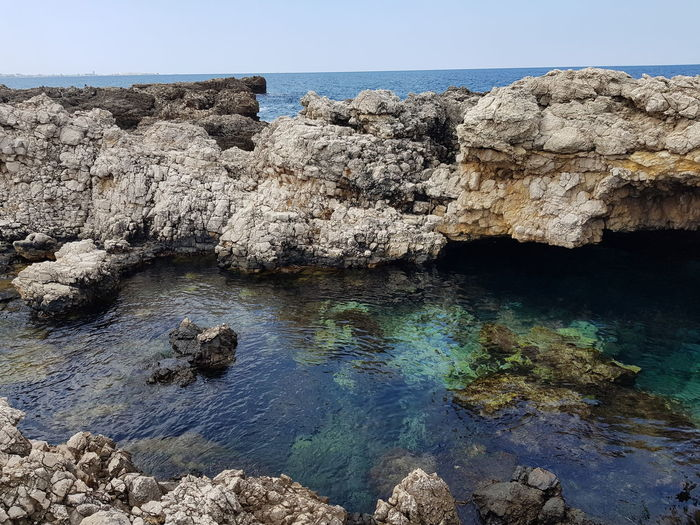Salento. Underwaterphotography Underwaterworld Francescopacienza Medsea Puglia Salento Seascape Summer Water Clear Sky Blue Rock - Object Sea Sky Rock Formation Natural Arch