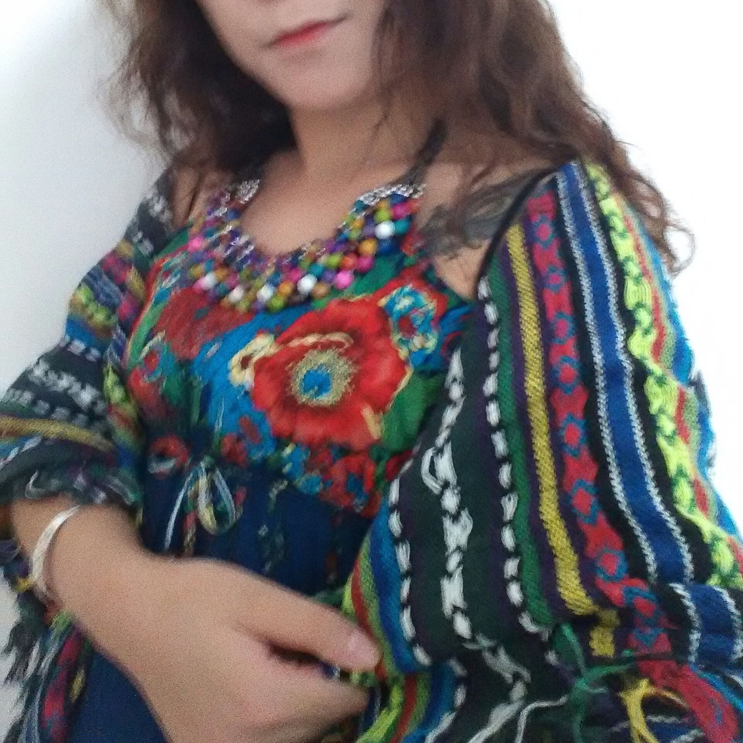 multi colored, lifestyles, leisure activity, indoors, front view, person, close-up, casual clothing, looking at camera, portrait, young women, young adult, colorful, midsection, childhood, fashion, headshot